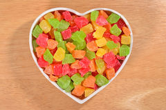 Candied fruits in plate in the form of heart Royalty Free Stock Photo