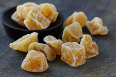 Candied ginger on a dark Royalty Free Stock Photos