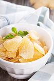Candied ginger in a jar. Homemade sugared candied ginger in a bowl royalty free stock photos