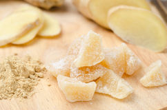 Candied Ginger On A Wooden Board Closeup Royalty Free Stock Photos