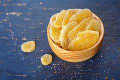 Candied ginger in a wooden bowl Stock Photography