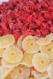 Candied hibiscus flowers and dried pineapple stock images