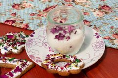Candied lilac flowers in glass jar Royalty Free Stock Image