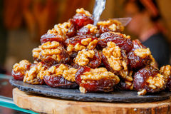 Candied nuts dates. Stock Photo