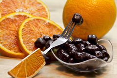 Candied orange bonbons covered by chocolate Stock Image