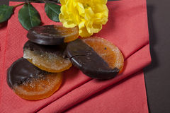 Candied orange with chocolate Stock Photos