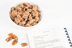 Candied Pecans with Cookbook Royalty Free Stock Photo