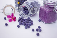 Candied petals of violets in the balls. Candied petals of violets in the form of pellets and sand Stock Photos