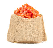 Candied pumpkin in the linen bag isolated on white background. Homemade sweetness of dried fruit. Stock Photos