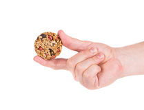 Candied roasted peanuts seeds in hand. Royalty Free Stock Photography
