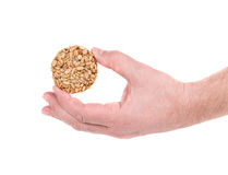 Candied roasted peanuts seeds in hand. Royalty Free Stock Image
