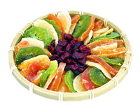 Candied tropical fruits. Exotic candied fruits in a traditional braided bowl Royalty Free Stock Photos