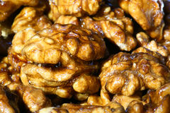 Candied walnut kernels. Close-up of candied walnut kernels Royalty Free Stock Photos