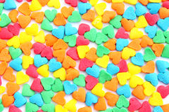 Candies. Texture from the many-colored candies in the form of the hearts Royalty Free Stock Photos