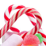 Candies. Closeup of some candy canes and other candies on a white background Royalty Free Stock Photos