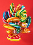 Candies. Twirl lollipop candies over a red background royalty free stock image