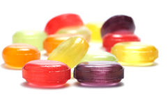 Candies. Some candies are isolated on a white background. Background blurred Stock Photos