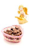Candies in basket and angel Stock Photos