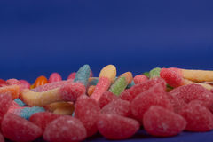 Candies. On a blue background royalty free stock photography