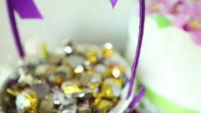 Candies and cake on wedding table. stock footage