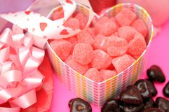 Candies and chocolate in heart shape box Stock Photos
