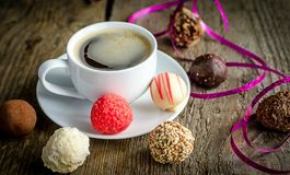 Candies and coffee Stock Photos