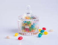 Candies or colorful candies in glass jar on background. Stock Photo