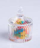 Candies or colorful candies in glass jar on background. Stock Photography