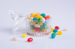 Candies or colorful candies in glass jar on background. Royalty Free Stock Images
