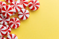 Candies colorful mix on yellow bright background with copy space Stock Photography