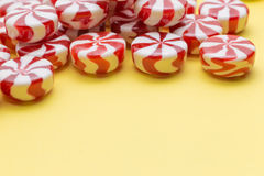 Candies colorful mix on yellow bright background with copy space Stock Photo