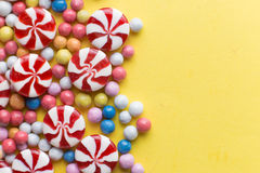 Candies colorful mix on yellow bright background with copy space Royalty Free Stock Images