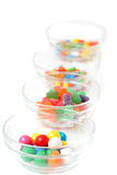 Candies in dishes stock photos