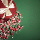 Candies, gift box on green background. Top view Royalty Free Stock Photos