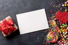 Candies, gift box and greeting card Royalty Free Stock Images