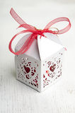Candies in gift box with red bow Royalty Free Stock Photos
