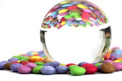 Candies with a glass ball Royalty Free Stock Images