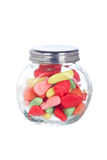 Candies in the glass jar. Colorful candies in the glass jar isolated on white background Royalty Free Stock Images