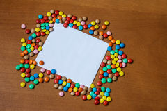 Candies and greeting card on wooden background. Top view Royalty Free Stock Photos