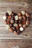 Candies on grey wooden background, heart Royalty Free Stock Photos