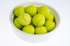 Candies gum balls in shape of tennis balls. Studio Photo stock image