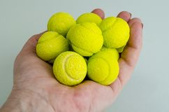 Candies gum balls in shape of tennis balls. Studio Photo royalty free stock images