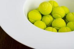 Candies gum balls in shape of tennis balls. Studio Photo stock photo