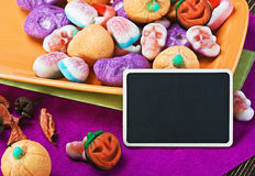 Candies for Halloween and blackboard Royalty Free Stock Photos