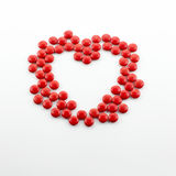 Candies in a heart shape Stock Photos