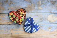 Candies in a heart shaped box Royalty Free Stock Images