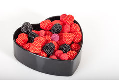 Candies in a heart shaped box Royalty Free Stock Image