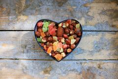 Candies in a heart shaped box Stock Photos