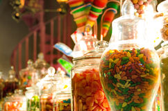 Jars of Candies in Honeydukes Candy Shop in Harry Potter World. An assortment of candies in glass jars displayed on in the Honeyduke`s candy shop in Hogsmead in Stock Images