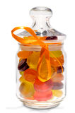 Candies in jar with a bow Stock Images